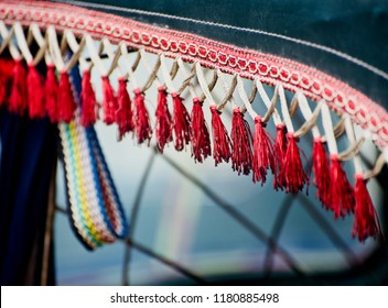 Red nylon ropes made decoration object of a CNG vehicle isolated unique blurry photo