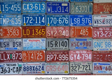 Red Oak, Missouri - July 19, 2017: Various old American license plates on wall. License plates are from various American states.
