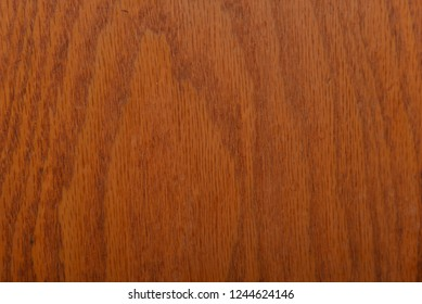 Red oak panel with natural woodgrain pattern can be used as a background or texture.