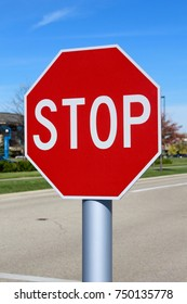 The red octagon stop sign on a close view.