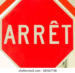 Red octagonal stop sign in french
