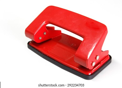 Red office paper hole puncher isolated on white background