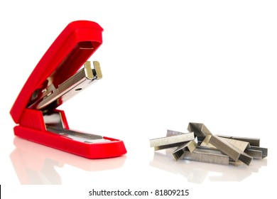 Red office stapler on a white background