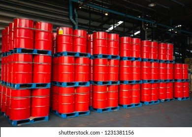 Red oil barrels chemical drums vertical stacked up Waiting for move