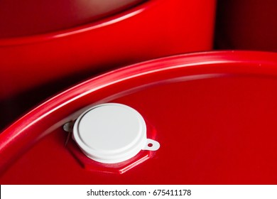 red oil steel container with white metal cap