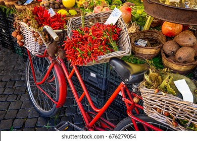 Red old bike in market on Campo di Fiori, Rome, Italy. Rome market on Piazza Campo di Fiori is landmark of Rome.