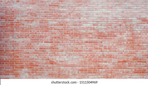 Red old grunge brick wall texture wide background, pattern of orange color stain aged weathered blocks of stonework horizontal architecture for interior background, wallpaper, web design template