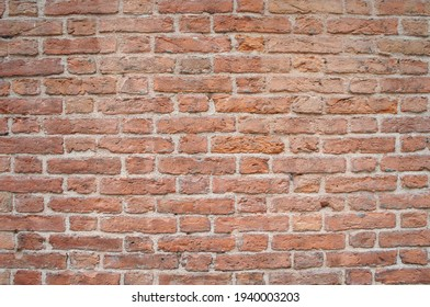 Red old medieval brick wall background