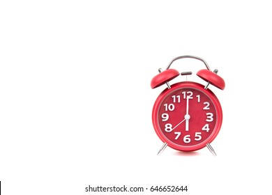 Red old retro style alarm clock on white background Alarm clock shows five minutes to 6 o`clock