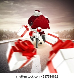 Red old santa claus on bike and splash of christmas boxes