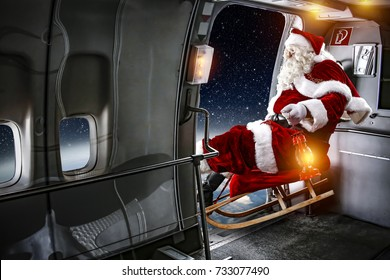 Red old Santa Claus in plane