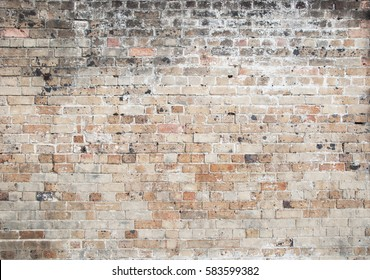 red old weathered exposed brick wall background