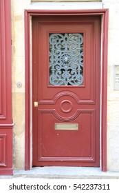 Red old wood door in Paris, France