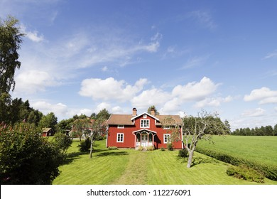 red old wooden houses, cottages 16th century in sweden