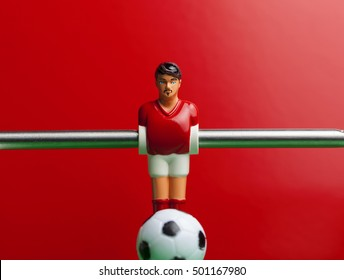red on a red background foosball table soccer .sport teame football players