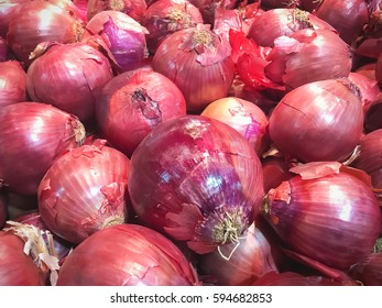 a lot of red onion background.