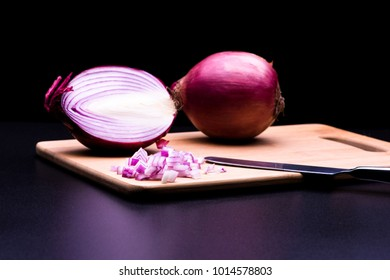 Red onion cut and all in black background