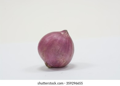 Red onion isolated on soft grey background