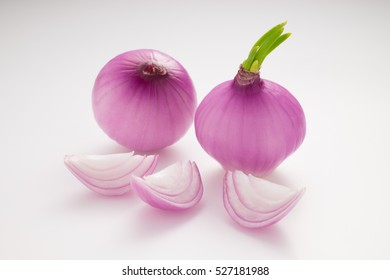 Red onion isolated on white background.