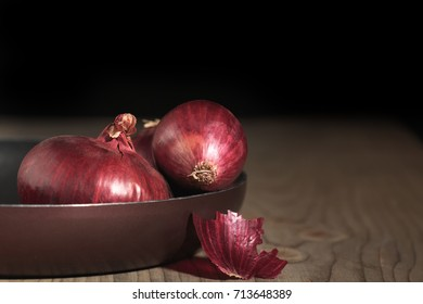 Red onion on the wood table. Agriculture - harvest.