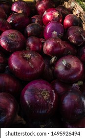 red onions at farmers market