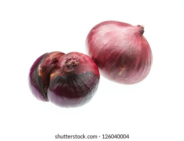 Red onions isolated on white background.