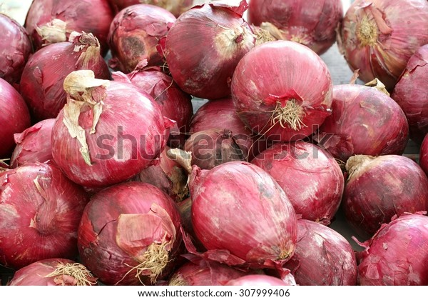 Red onions on display for sale at farmer's market
