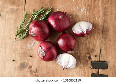 red onions on a wooden cutting board