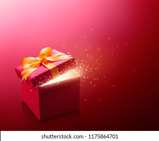 Red open gift box with glittering
