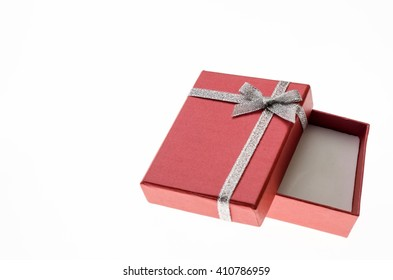 Red open gift box with a silver ribbon