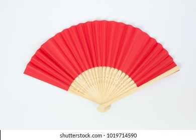 Red Open Hand Fan Isolated on a White Background.