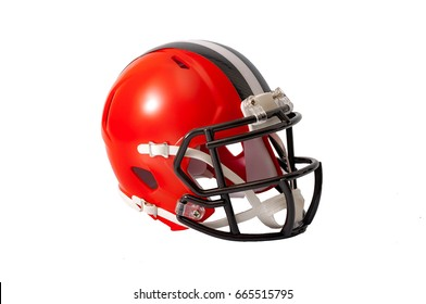 Red or orange american football helmet with black and grey stripe along the crown of the helmet isolated on a white background