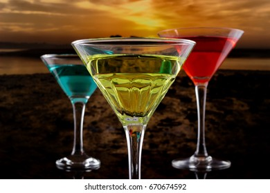 Red orange and blue cocktail with sunset background