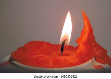 Red orange candle dripping likely candle flame