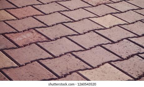 Red and orange interlocking brick