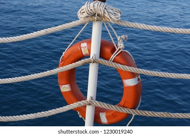 Red Orange Lifebuoy on the Background of the Sea. Lifebuoy Aboard Ship or Pier.