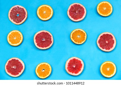 Red and orange oranges  on the blue background