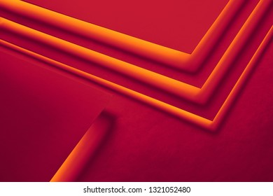 Red and orange paper concept background and copy space. Orange geometric layer design with group of paper sheets. Flat lay