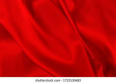 Red and orange silk or satin luxury fabric texture can use as abstract background. Top view.