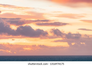 Red orange sky after sunset over sea water surface