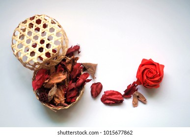 Red origami rose and dry flower spread out from Thai wicker, love concept, Valentine concept.