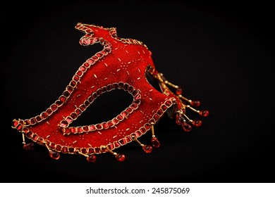 Red ornate Venice mask isolated on black
