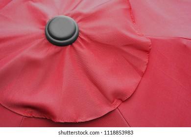 Red outdoor patio umbrella close-up