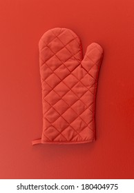Red oven mitt on red background