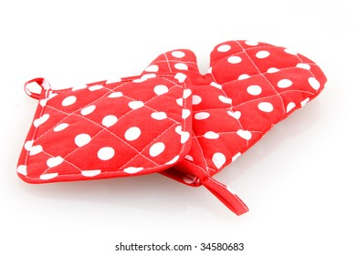 Red oven mitt and potholder isolated on white background