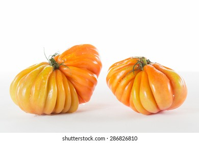 Red ox heart tomatoes on a white background