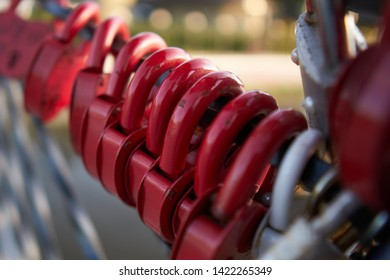 A lot of red padlocks on the bridge.