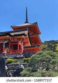Red Pagoda In The Famous Kiyo-mizu Dera Temple In Kyoto, photo taken on a beautiful sunny day.
