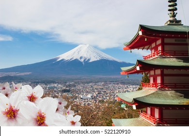 Red Pagoda with Mt Fuji background and cherry blossom