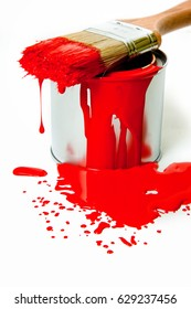 red paint with brush in silver can